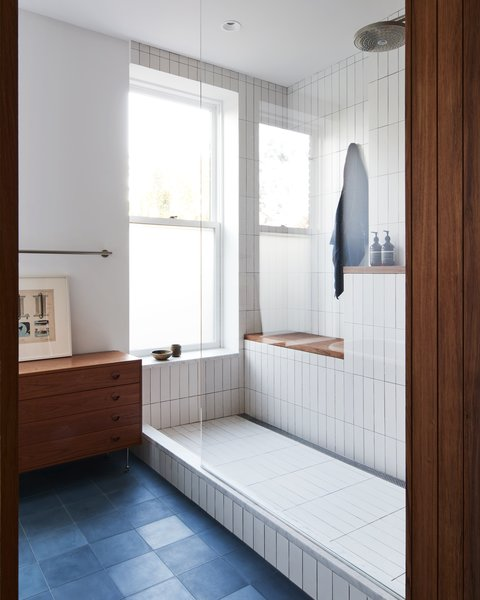 In the new bathroom, Heath Ceramics tiles were used in the shower alongside cement tile flooring from Clé Tile.