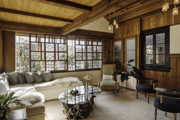 Original wood features mix with airy daybeds at the front of the property.