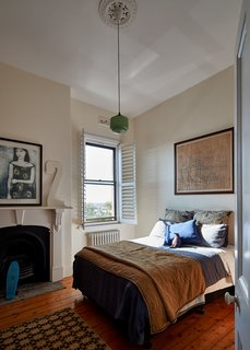 Small bedroom ceiling lighting ideas include simple, diminutive choices, like this funky mint green pendant seen here.