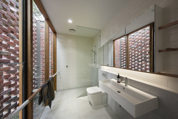 The custom towel rails in this bathroom are also meant to mimic branches.
