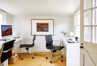 The traditional office is located toward the back of the house, but maintains a minimalist feel.