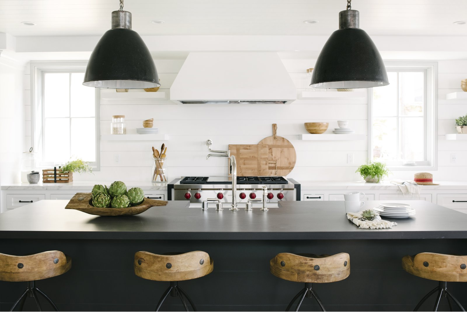 Kitchen, Engineered Quartz Counter, Recessed Lighting, White Cabinet, Wood Backsplashe, Range Hood, Pendant Lighting, and Range Interior design photographers Lauren Pressey, Amy Bartlam, and Tessa Neustadt teach you how to prepare for—and execute—a flawless home photoshoot.  Photo 1 of 7 in Pro Tips: How to Style and Shoot Your Modern Home