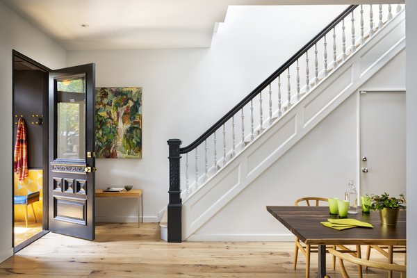 """""""We put a big skylight over the stairwell in order to bring light into the center of the house, and we opened up the stairwell to maximize how much light reached the first floor,"""" Barker says."""