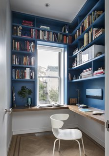 """""""I particularly love the blue paint on the custom millwork in the small office on the second floor,"""" Barker says. She used paint to make an impact throughout the home without breaking the bank."""