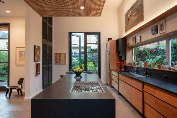 """""""It was important that the kitchen was open for both entertaining and for daily use. The cook top is in the island so the cook and the food is the focus of the conversation,"""" Troyer says."""