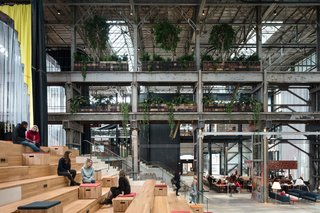 The renovation of this one-time locomotive shed into a multipurpose library still kept its industrial aesthetic.