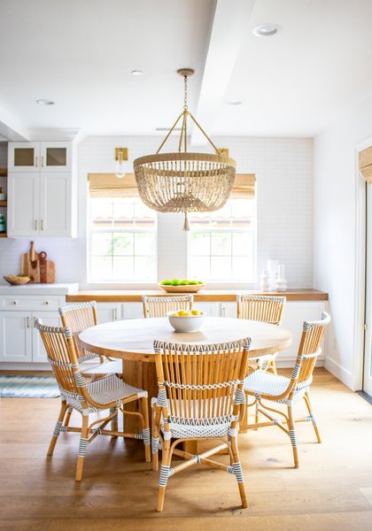 Owens sourced the dining table from Restoration Hardware, and picked up the bistro chairs from Wayfair. The beaded Ro Sham Beaux chandelier has custom-made beading.