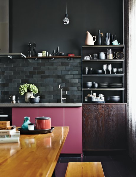If you're itching for color in your kitchen, consider installing a striking black backsplash—it's sure to complement any shade that's near it.