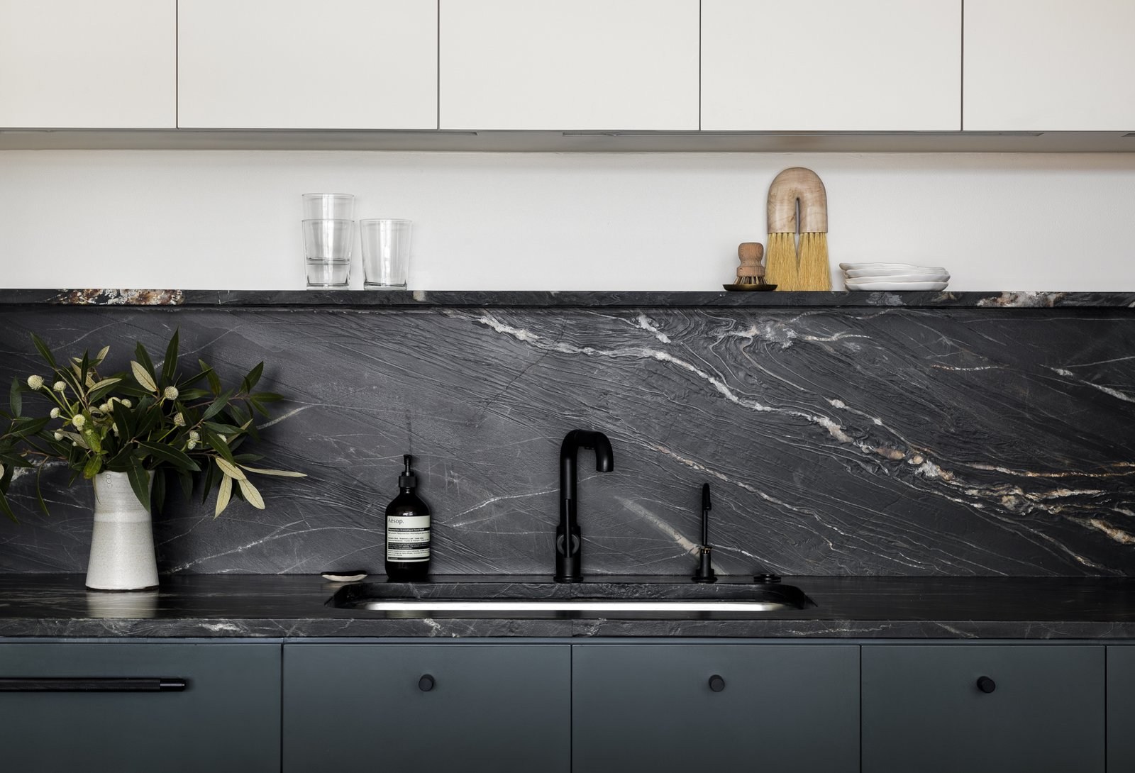 """Kitchen, Drop In Sink, Wood Cabinet, Stone Slab Backsplashe, White Cabinet, Open Cabinet, Colorful Cabinet, and Granite Counter """"The owners wanted to stay away from marble for durability reasons and didn't like the look of a lot of traditional granites,  Photo 5 of 11 in This Airy Portland Loft Was No Easy Task to Transform"""