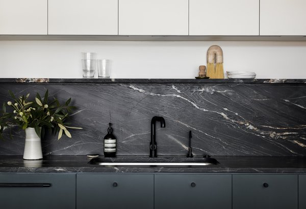 """""""The owners wanted to stay away from marble for durability reasons and didn't like the look of a lot of traditional granites,"""