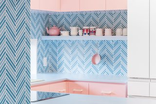 The design's color blocks are contrasted by the herringbone pattern of the backsplash, which still works with the pastel palette.