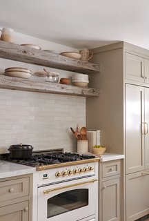 The rustic wood used for the open shelving was sourced locally, and a carpenter based in the area made the cabinetry.