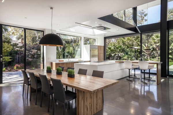 """They wanted a very friendly, functional, and warm kitchen,"" Maydan says. Meital adds, ""We cook a lot and have a lot of friends. We are French people!"" Sub-Zero, Wolf, and Bosch appliances mix with a Restoration Hardware dining table and BoConcept chairs."