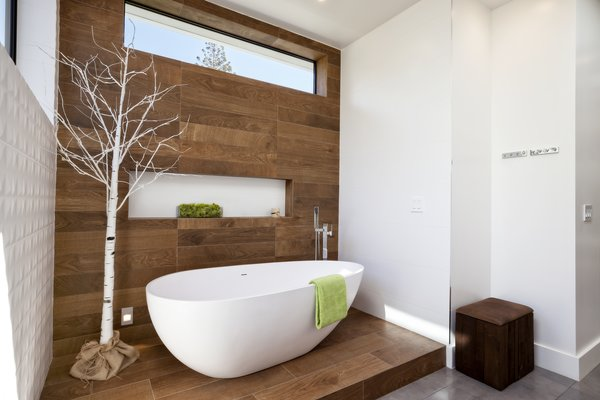An Ethos bathtub contrasts woodwork by Porcelanosa in the master bathroom.