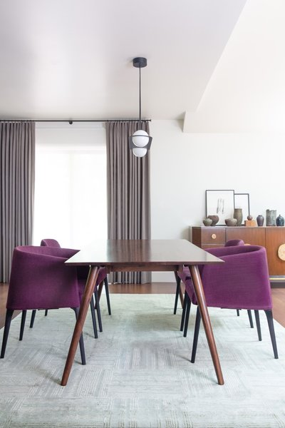 The owners asked to keep their magenta chairs, which Hope-Kennedy paired with a midcentury dining table.