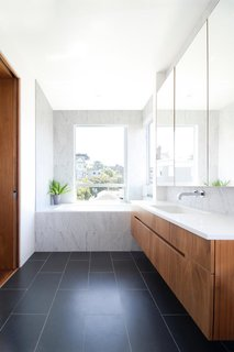 Bath Room, Wall Mount Sink, Soaking Tub, and Alcove Tub A simple fern can add color and movement to a bathroom corner, and it especially likes the humid temperature.