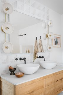 """Maziarski's advice for renovating your master bath? """"While your sanctuary doesn't need to mimic a Greek villa, take a moment to look at your space and identify a few things that can make it your own retreat,"""" he says."""