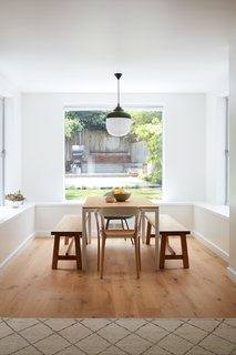 The pendant lamp above the dining space combines Western industrial touches with an Asian wink at paper lanterns. It was the basis of the renovation's design.