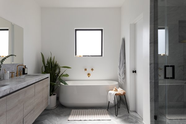 The master bathroom is in keeping with the home's neutral palette, which is inspired by Scandinavian minimalism.