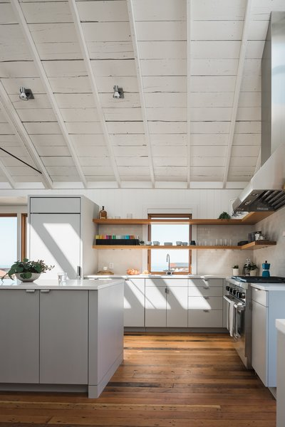 """Caesarstone countertops were selected for the kitchen, alongside a Sub-Zero refrigerator and a Wolf gas range. """"We picked a Chicago faucet, because the owner loved how it hadn't changed in 100 years,"""" Davis says."""