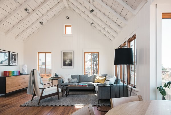 The roof was lifted and insulated during the renovation, and the original Douglas fir floors were kept and patched where needed. The oversized thermal windows also regulate the temperature.