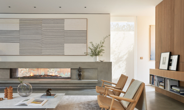 On the rare occasion that the weather is chilly, an expansive concrete fireplace can warm up the living area.