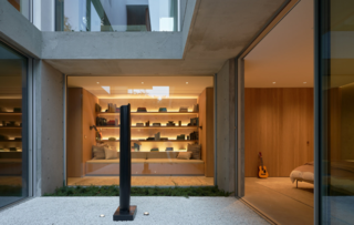 """""""The home centers around a vertical courtyard that connects all three volumes, along with adjacent terraced gardens,"""" he says. This feature brings light into every room of the home, including the basement, while also keeping them cool."""
