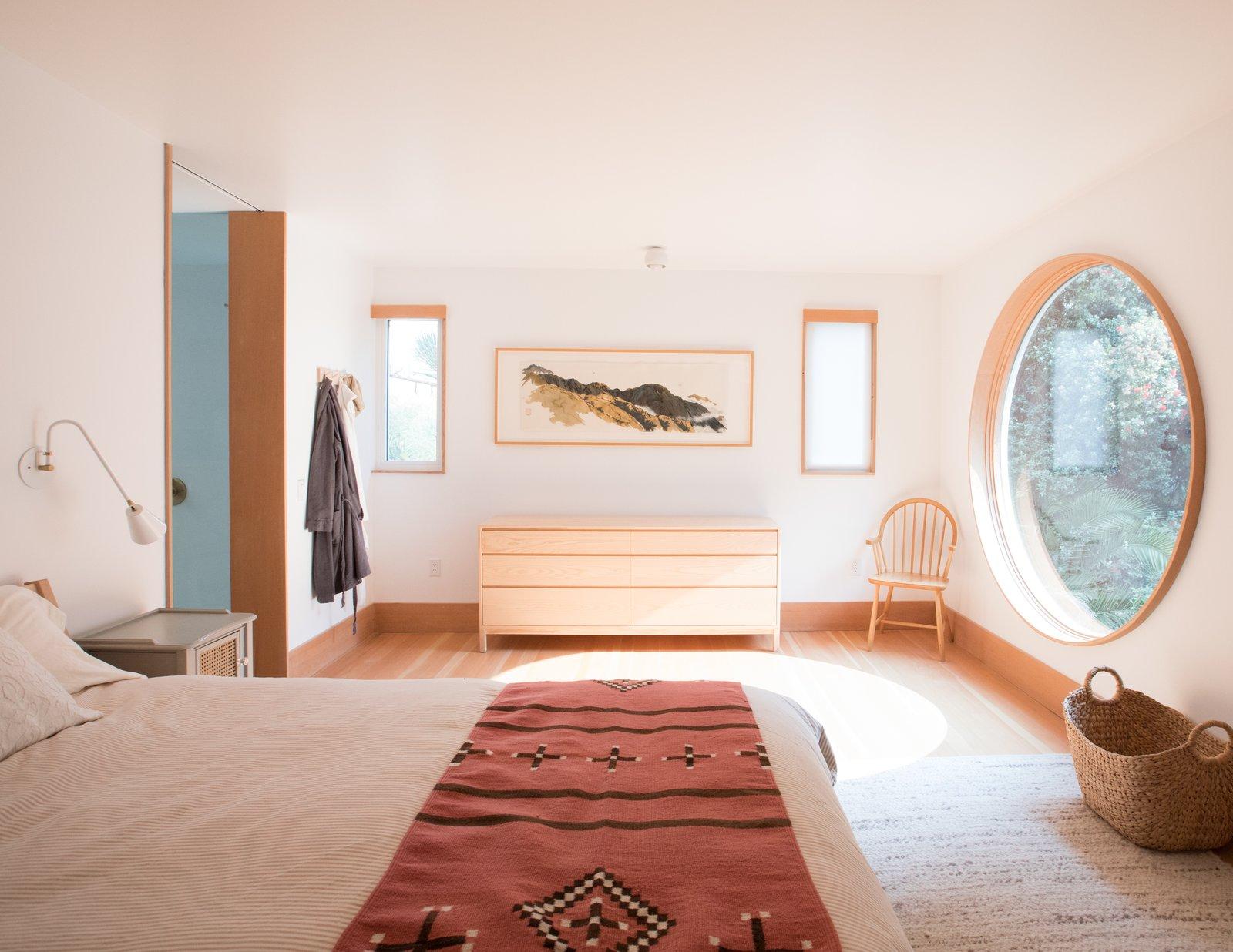 Carriage House by Medium Plenty bedroom with circular window