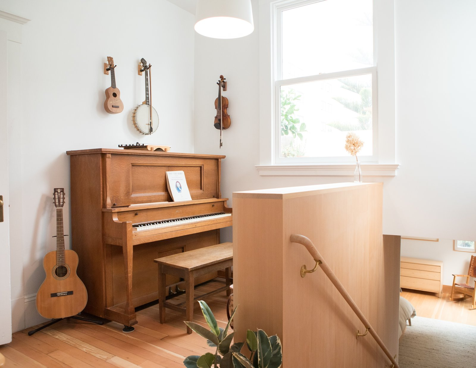 Carriage House by Medium Plenty music area at the top of a staircase