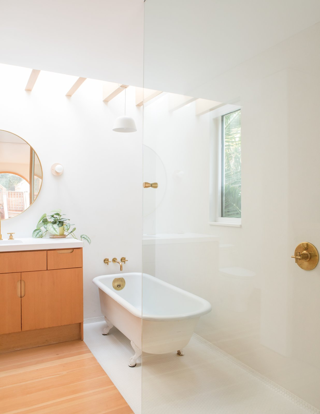 Carriage House by Medium Plenty glass-partitioned bathroom with open shower