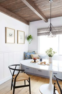 "The breakfast nook is a new addition, and takes the place of where a dining room once was. The bench storage ""makes the kitchen feel much more organized now,"