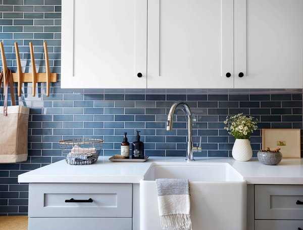 Macdonald installed a Signature Hardware farmhouse sink in the defined laundry room, and surrounded it with storage.