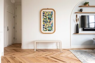 Evan Jewett fabricated a custom Murphy table with white oak to match the floors, which were inspired by a room in the Williamsburg Hotel designed by Michaelis Boyd Studio of London. The art print is framed Hockney wallpaper from Milton and King.