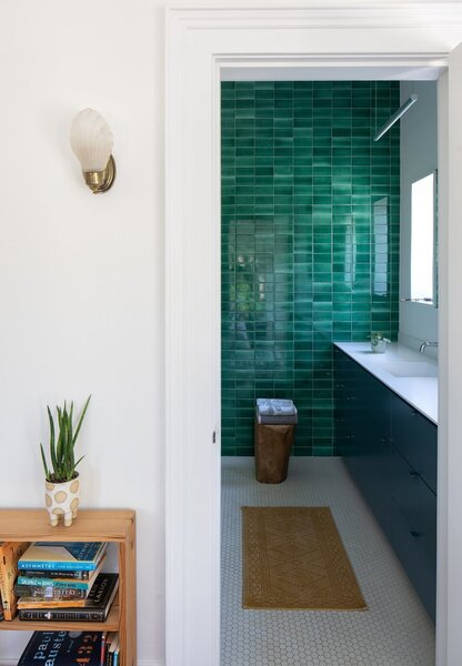 A bathroom inside a Florida property first built in the 1920s receives a renovation featuring mermaid-green subway tile.