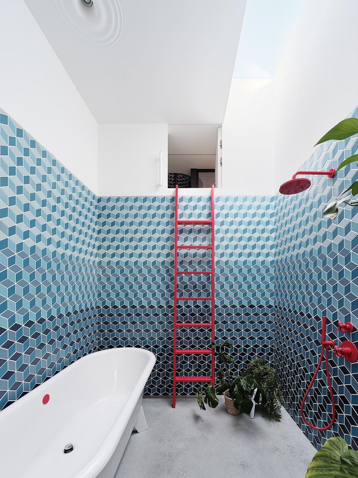 bathroom with geometric blue tile