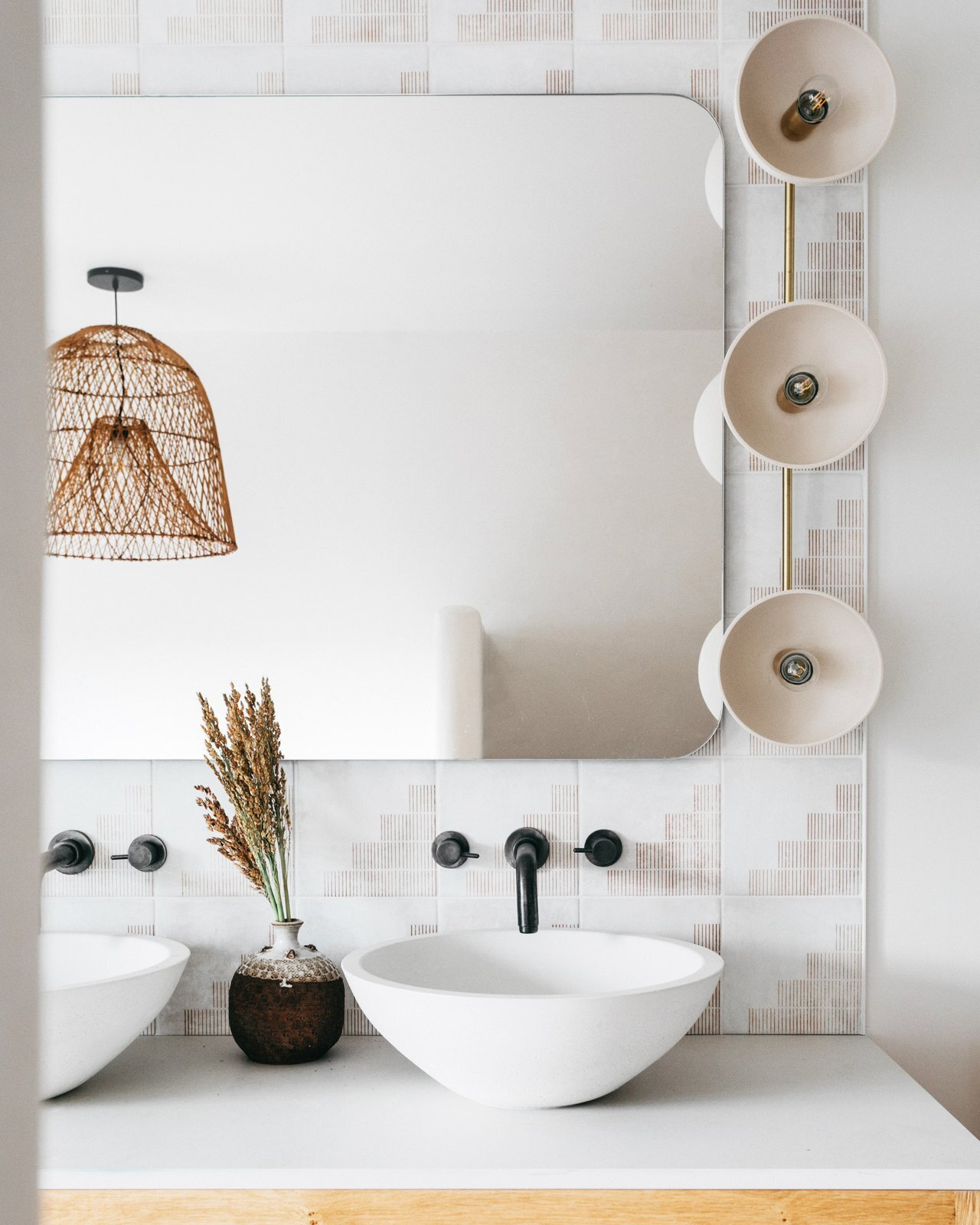bathroom with geometric white-and-beige tile