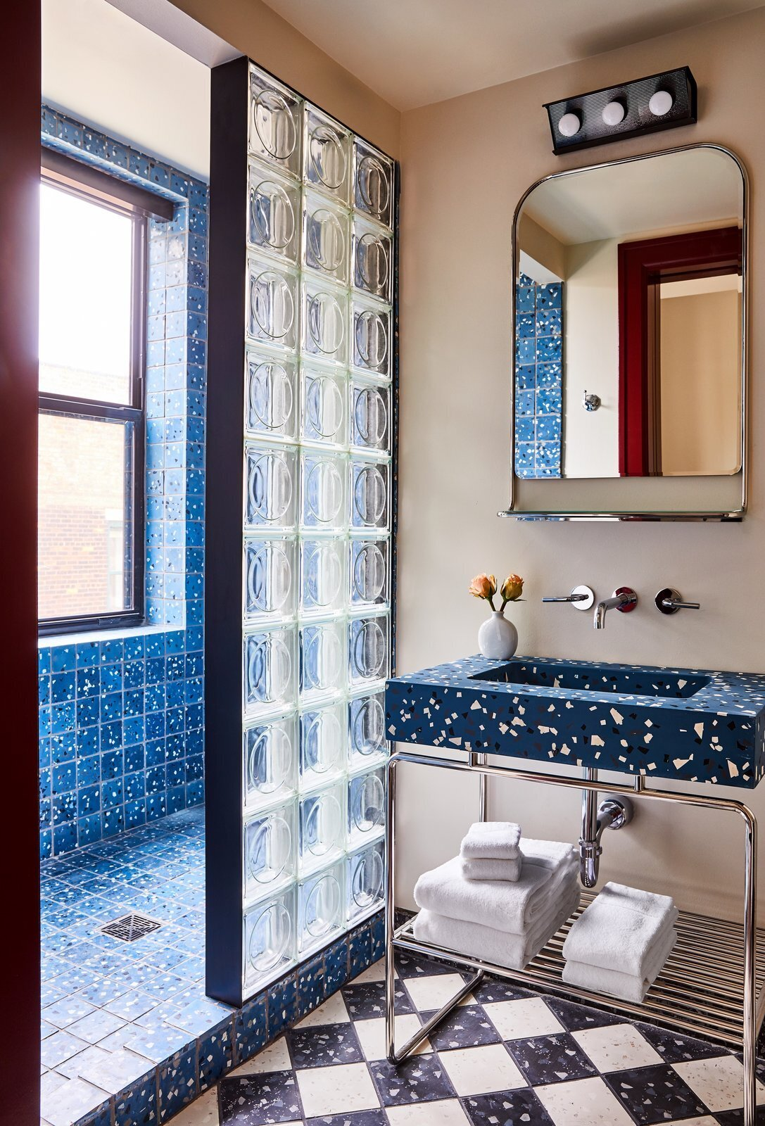 bathroom with blue tile and glass blocks