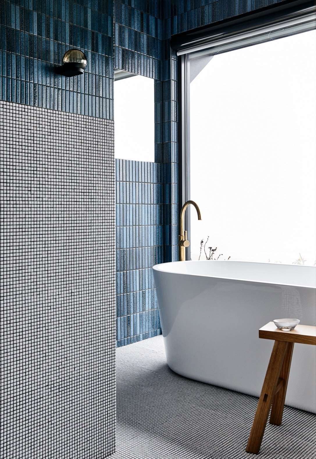 bathroom with blue and white micro tile