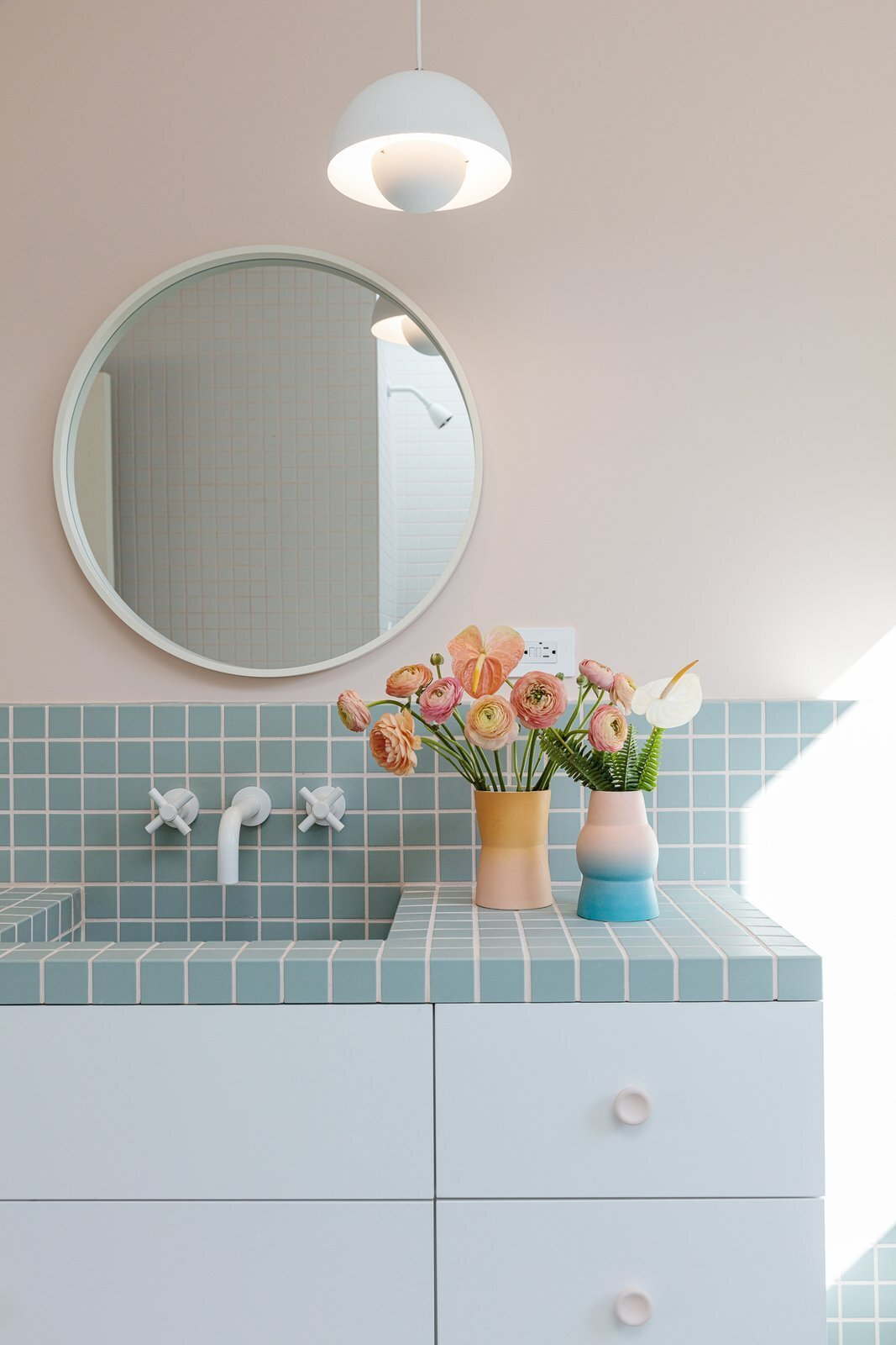 bathroom with pink walls and blue tile