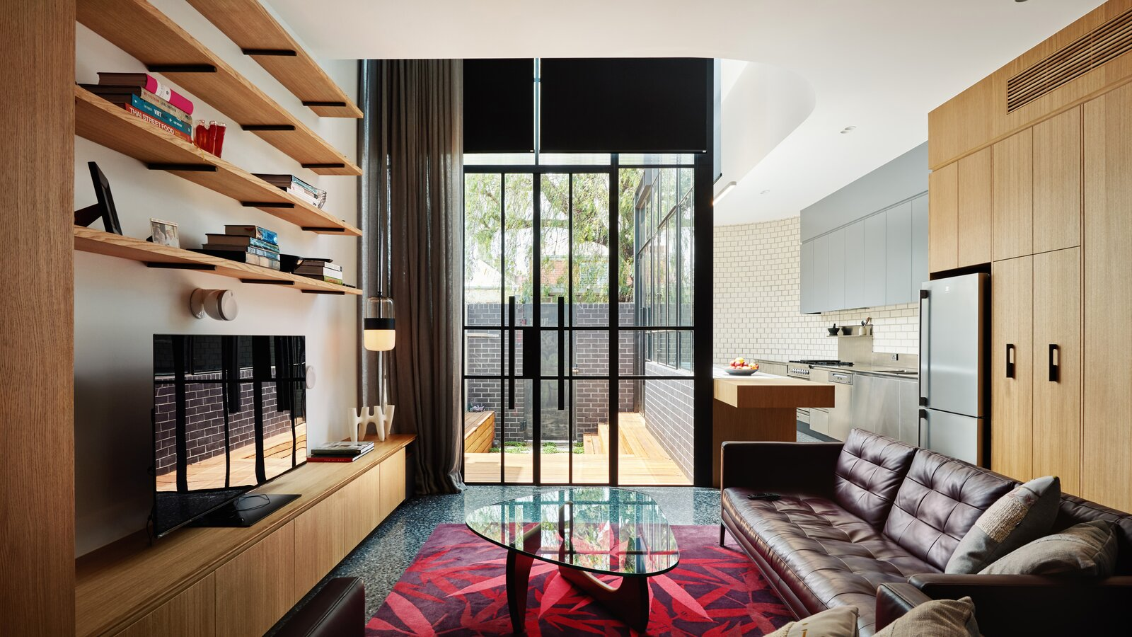 Turn House by Rebecca Naughtin Architect living room with double-height glass doors