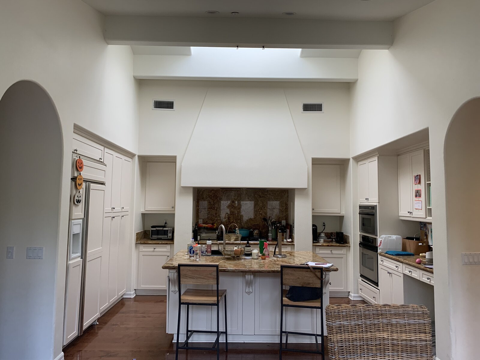 """Before: """"The original kitchen lacked usable counter space and had a built-in desk area that ended up being a landing zone for clutter,"""" says interior designer Katie Gebhardt.  Photo 1 of 8 in Before & After: A Sparkling Kitchen-and-Bath Renovation Elevates a San Diego Home"""