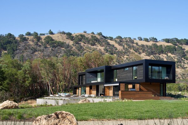 """""""By using a hybrid model that includes both prefab and site-built construction, we were able to push the architectural vocabulary of prefab construction beyond the expected, with a bold, new visual vocabulary,"""" Denton says."""