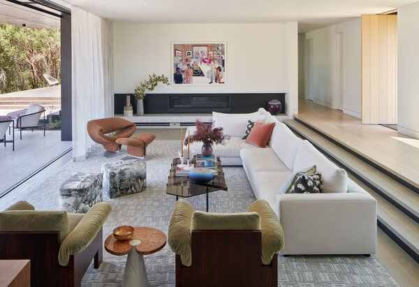 """""""The clients' art collection is so inspiring and engaging that we wanted to make sure that our design decisions enhanced the collection and didn't overpowered the artwork,"""" Damonte says. The living room and deck were constructed on-site."""
