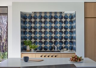 A handmade Fireclay backsplash resembles turntables as a nod to the couple's love of music.