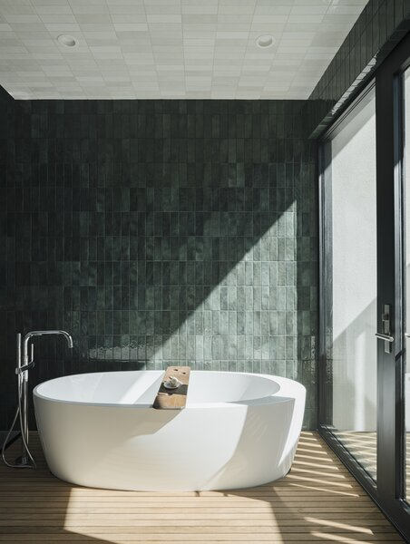 Bedrosians ceramic tile was used on the walls and ceiling in the master bathroom.