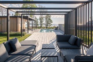 The pergola overlooks the pool with the Baltic Sea in the distance. The couple built the home so that there would be as much outdoor space as indoor space.