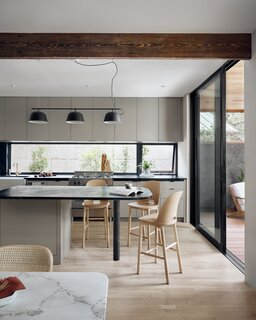 A long window was used as a backsplash in the kitchen to bring in even more light to the space.