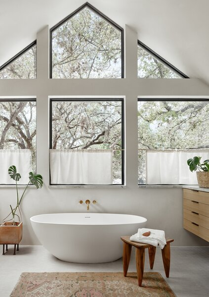 A primary suite was created on the new second level, complete with a freestanding tub.