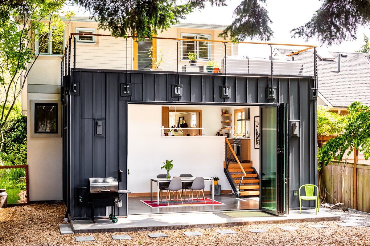 Exterior, Flat RoofLine, Metal Siding Material, and House Building Type Exterior view - doors open  Ballard Residence