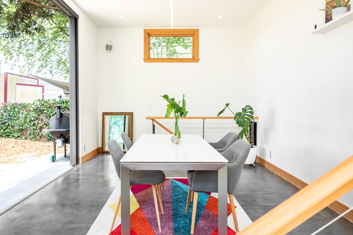 Dining Room, Chair, Pendant Lighting, Table, Recessed Lighting, and Concrete Floor Dining room  Ballard Residence